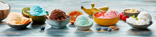 Assorted Ice Cream Scoops In Bowls On Table