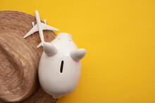 Saving For A Summer Vacation. Money Piggy Bank With Holiday Travel Accessories