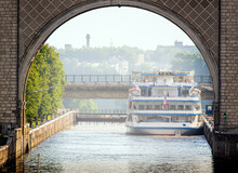 A Four-deck River Boat Passes The Sluice In The Ancient City Of Uglich.