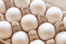 Top View Of Fresh White Eggs In An Egg Carton