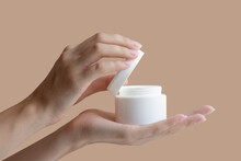 Women's Hands Open Mock-up Of Jar Of Cream, Showing Contents On Beige Background. Concept Of Beauty Industry, Body Care