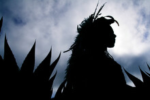 Silhouette Of An Indigenous Indian Dancers.