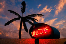 Welcome Sign In Neon With Palm Tree
