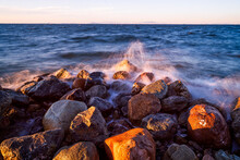 Sunset Time Sea Waves Hitting To Rocks
