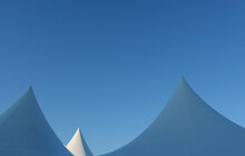 Cone Shaped Tents Against Clear Blue Sky, Minimalism Concept