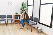 Young Asian Woman Sitting At Waiting Room
