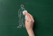 Woman Wiping Off Drawn Human Figure On Color Background. Concept Of Dismissal