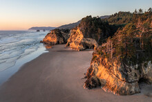 Sunset On The Beach During Low Tide At Hug Point In Cannon Beach Oregon