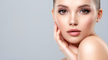 Closeup Portrait Of A  Face Of The Young Pretty Girl With A Healthy Skin. Beautiful Face Of Young White Woman With A Clean Skin. Skin Care Concept.