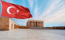 Anitkabir, Mausoleum Of Ataturk With Dramatic Cloudy Sky On The Background Blured Image Of Turkish Flag - Ankara Turkey