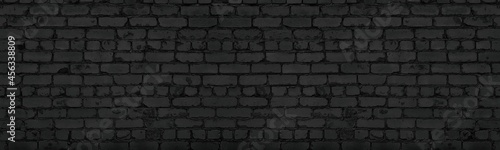 Photo Black old rough shabby brick wall wide panoramic texture
