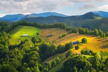 Farmland And Farm Houses On Hillside In Beautiful Sunlight In Transylvania
