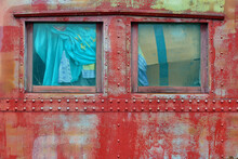 Weathered Wood And Windows On An Old Caboose