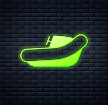 Glowing Neon Inflatable Boat With Outboard Motor Icon Isolated On Brick Wall Background. Vector