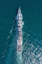 Aerial View Of Naval Ship, Battle Ship, Warship, Military Ship Resilient And Armed With Weapon Systems, Though Armament On Troop Transports. Support Navy Ship. Military Sea Transport.