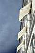 canvas print picture - Hausfassade mit ausgeklappten Sonnensegeln in Kopenhagen