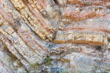 Curious Rock Formations On The Side Of A Mountain, With Detail Of The Veins And Sedimentation Layers.