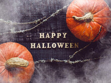 Happy Halloween. Pumpkins Lying On The Table. Close-up, View From Above, No People. Congratulations For Loved Ones, Relatives, Friends And Colleagues. Holiday Concept