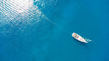 Amazing View To Yacht, Swimming Woman And Clear Water.