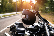 Motorcycling As A Way Of Life, Image Of Parked Bike On The Road With Helmet Hanging From The Throttle Bar