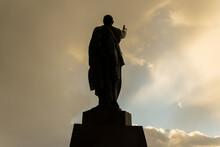 Statue Of A Man With His Hand Raised
