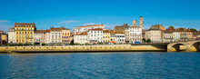 View Of Macon Cityscape Across Saone River On Blue Autumn Sky As Background, France..