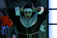 Woman Dressed As Nun At Halloween Party