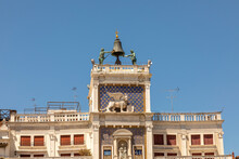 View To Famous Clock Tower With Hammering Men At St. Mark's Square In Venice, Italy