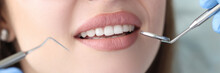 Portrait Of Woman With White Beautiful Teeth At Dentist Appointment