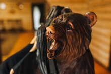 Sculpture Of A Wooden Bear With An Open Mouth Close-up.