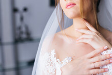 Morning Of The Bride. Portrait Of A Young Beautiful Tender Bride With Red Lips In A White Lace Wedding Dress Gracefully Put Her Hand On Her Neck.