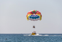 Turkey, Alanya, Side, 27.08.2021: Extreme Entertainment, Tourists On A Parachute Climb On A Rope From A Boat, Ride A Parachute On A Rope Over The Sea