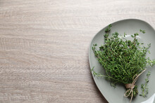 Bunch Of Aromatic Thyme On Wooden Table, Top View. Space For Text
