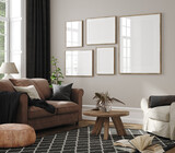 Frame mockup in home interior, living room in neutral colors with sofa, armchair and dry flower on table , 3d render