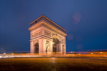 Triumphal Arch With Sculptures On Pavement In Night City