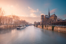 Motor Ship On Seine River At Sunset