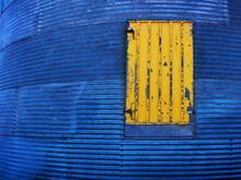 Yellow Painted Door On Steel Grain Silo Granary Texture