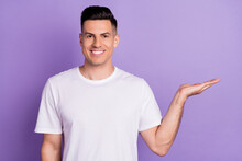 Photo Of Young Positive Happy Man Hold Hand Empty Space Sale News Good Mod Isolated On Purple Color Background