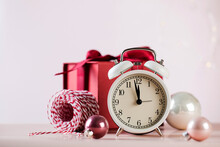 Christmas Composition With Alarm Clock Baubles And Gift Box. Copy Space.