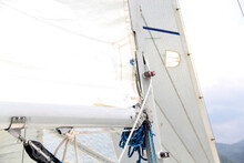 Parts Of A Sailboat That Is Sailing On The Lake With Sails Out, Bow, Stern, Sheet, Mast, Rudder, Weather Vane