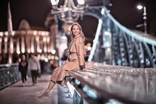 Girl In A Coat, Spring Glance, Night Walk In Budapest Chain Bridge Landscape