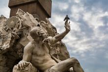 A Statue Of The Rio De La Plata River God,  Part Of The Fontana Dei Quattro Fiumi (Fountain Of The Four Rivers),  In The Piazza Navona, Rome, Italy