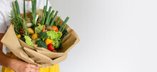 Close-up Photo Of Woman Holding Fresh Vegetables Decorated Into A Bouquet.