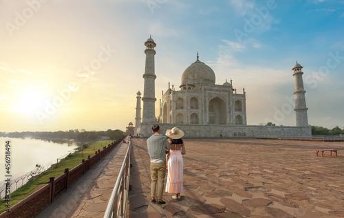 Fototapeta Taj Mahal Agra historic white marble mausoleum at sunrise with view of tourist c
