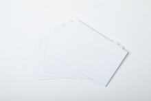 Composition Of Blank White Cards With Copy Space On White Background