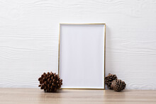 Composition Of White Card In Frame With Copy Space And Pine Cones On White Background