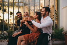 Cheerful Couple Friends Toasting With Wineglasses On A Double Da
