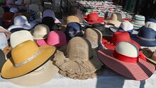 Jute And Straw Summer Hats For Women On A Market Stall.