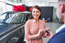Unrecognized Man Presenting New Car To His Wife