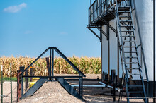 Ramp And Stairs Over A Secondary Containment Dike For Chemical Oil Storage Confined Space